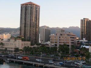 Honolulu, a bustling, thriving city with a sparkling harbor, world famous beaches and impressive craters.