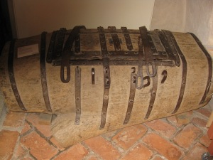 A wooden barrel with several locks which served as the church safe.